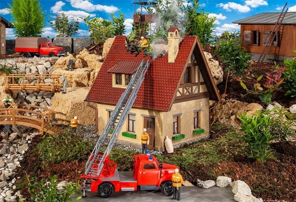 G Brennendes Haus